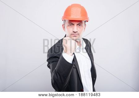 Mad Contractor Wearing Hardhat Showing Fist Like Fighting