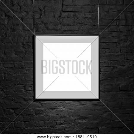 Empty square frame on black brick wall. Blank space poster or art frame waiting to be filled. Square Black Frame Mock-Up.