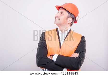 Side View Of Foreman Wearing Hardhat And Vest