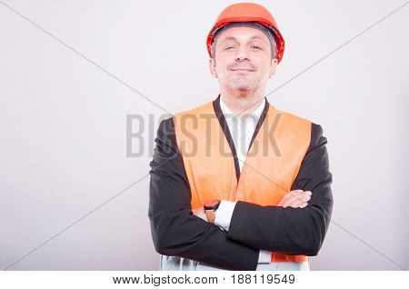 Portrait Of Foreman Wearing Hardhat And Vest