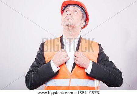 Contractor Wearing Hardhat Arranging His Jacket