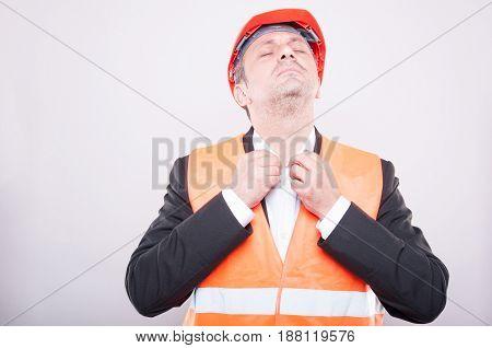 Contractor Wearing Hardhat Arranging His Shirt
