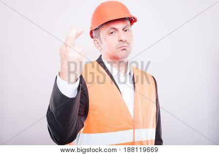 Engineer Wearing Hardhat Making Fingers Crossed Gesture