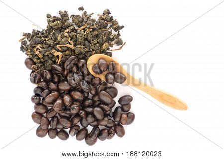 Coffee bean and tea leaves top view with wooden spoon on white background