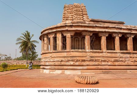 AIHOLE, INDIA - FEB 9, 2017: Tourists watching facade of the 7th century Durga temple famous Hindu structure temple on February 9, 2017. Population of Karnataka state is 62000000 people