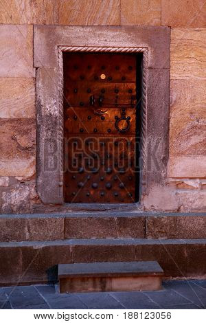 Metal door in rivets. The Sioni Cathedral of the Dormition in Georgia. Caucasus