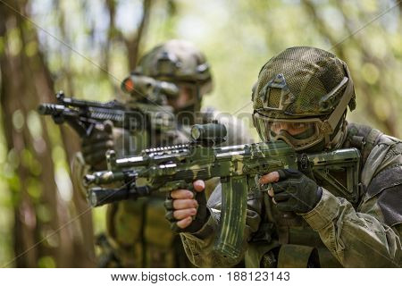 Two soldiers in military intelligence at forest