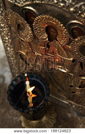 glass icon lamp in front of the antique icon of Christ the Savior