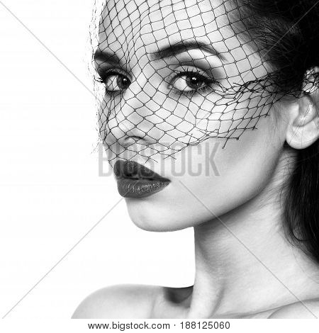 closeup beauty fashion portrait of young beautiful girl in black veil and with red lips isolated on white background. Black and white colors portrait