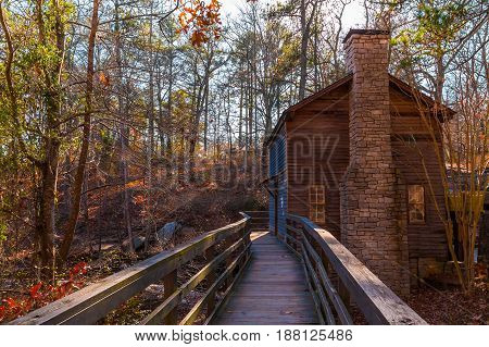 View of the Grist Mill and thicket from the bridge in the Stone Mountain Park in sunny autumn day Georgia USA