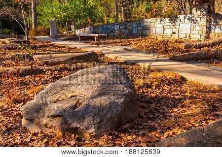 The big boulder closeup and footpath in the Stone Mountain Park in sunny autumn day Georgia USA