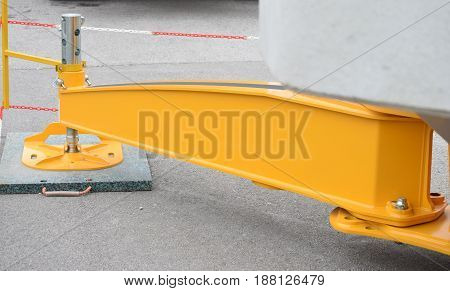 One of the four pins for fixing crane carrier to the base