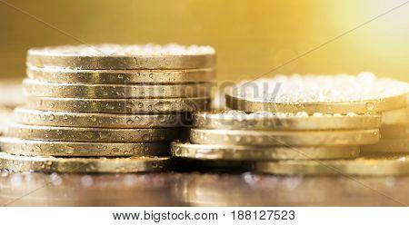 Golden coins closeup - web banner of money savings concept