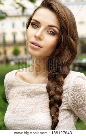 outdoor summer portrait of young beautiful girl with braid