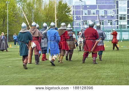 Moscow - May13 2017. Reconstraction of medieval battle beetween russian and european warriors on school foorball field