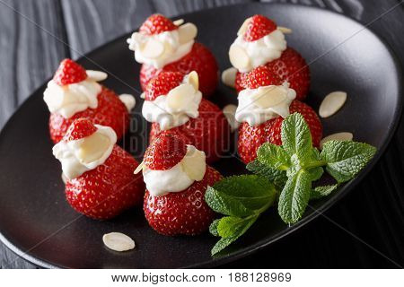 Fresh Strawberries With Almonds And Whipped Cream On A Plate Close-up. Horizontal