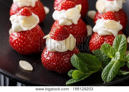 Organic Strawberry Stuffed With Whipped Cream, Almonds And Mint Closeup. Horizontal