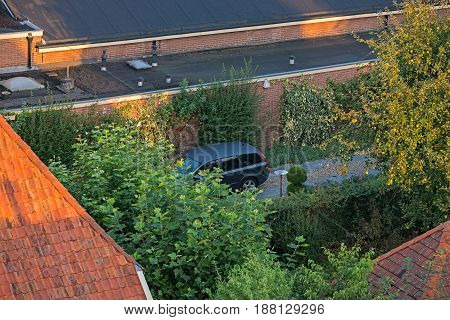 High Angle View Of Parked Vehicle On Private Driveway.
