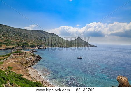 lighthouse and boat in idyllic aegean sea in knidos in Datca Turkey