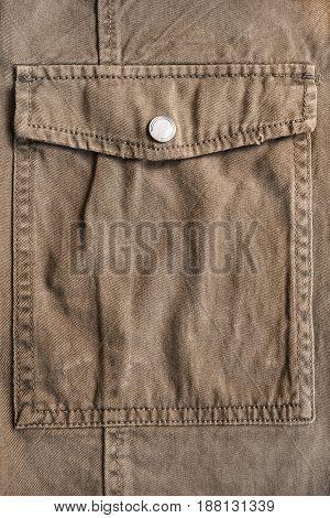 Brown denim jacket pocket closeup as a background