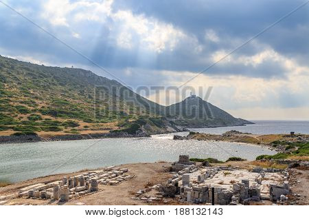 Ancient greek city knidos remmants and lighthouse with sun rays