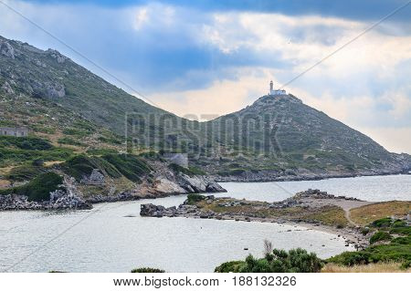 Lighthouse in knidos ancient greek city with sun rays in Datca Turkey