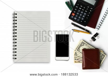 White office desk with smartphone with black screen pen wallet and supplies. Top view with copy space.