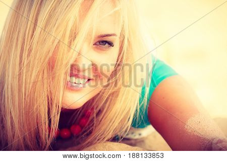 Woman Lying On Sandy Beach Relaxing During Summer