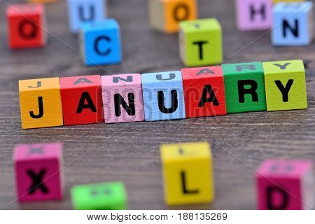 January word on wooden table close up