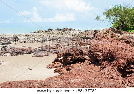 The Red Stone And Rock On The Sand Beach In Clear Blue Sky And Noon Time Period