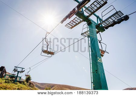 Ski Lift With Blue Sky And Sun On The Background