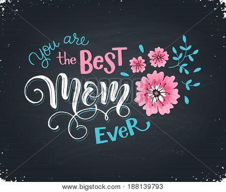 Happy Mothers Day greeting card. You are the best mon ever text with flowers hand drawn on blackboard. Hand drawn lettering in tender colors.
