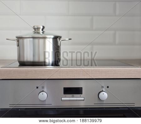Pot On Electric Stove In Modern Kitchen