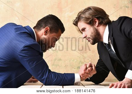 Two Businessmen Doing Arm Wrestling, Winning And Loss