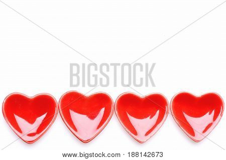 Pattern Made Of Red Ceramic Heart Shaped Saucers