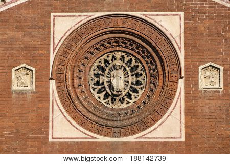 Milan (Lombardy Italy): rose window of the Sant'Eufemia church built from the 16th century in neo-Romanesque and neo-Gothic style