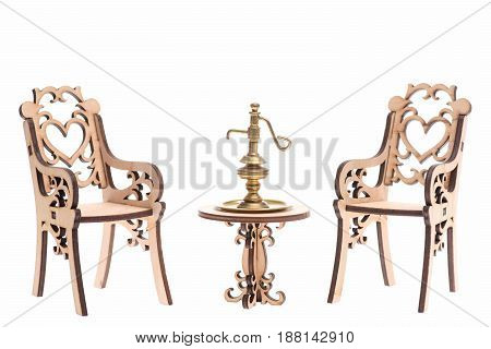 jug or lamp ancient golden ware on decorative wooden table with chairs isolated on white background. Arabian concept