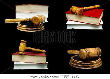 Wooden judge hammer and book on a black background. Horizontal photo.