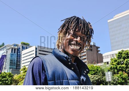 June 14 2017- A tourist African-American man with a big smile in his face and a dreadlocks hairstyle is visiting Downtown Vancouver,BC Canada from New York City USA