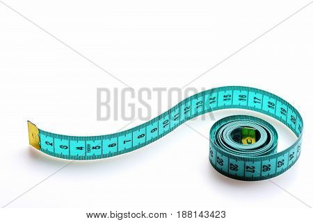 Coil Of Greenish Blue Tape For Measuring Unrolls Wavy