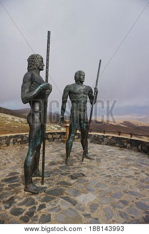Fuerteventura - Bronze statues of two kings Ayose and Guise at the pass of Betancuria.