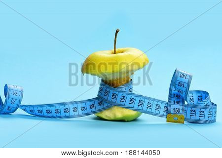 Apple Fruit Tied Around With Blue Twisted Measuring Tape