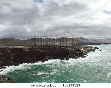 View to Ajuy coastline with vulcanic mountains on Fuerteventura island, Canary Islands, Spain.
