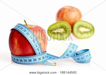 Apple Of Fresh Red Color Belted With Blue Measuring Tape