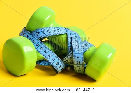Taut Body Concept With Dumbbells And Measuring Tape