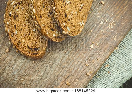 Fresh bread on a cutting board. Natural healthy food concept.