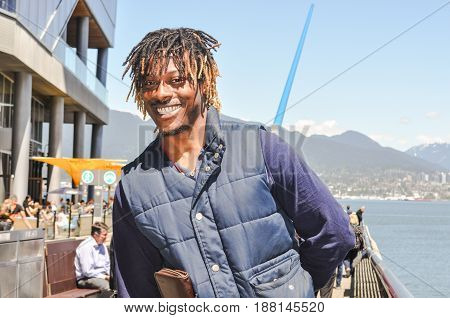 June 14 2017- Portrait of happy African-American with dreadlocks hairstyle and a tourist person in Vancouver,BC Canada