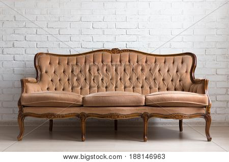 Vintage Sofa Over White Brick Wall