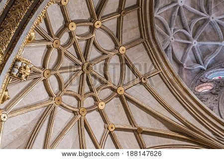 Almeria SPAIN - May 19: Interior of Cathedral of the incarnation detail of vault formed by pointed arches borders and nerves gilded in the shape of flower placed in Almeria unique nature of fortress built in the 16th century Andalusia Spain