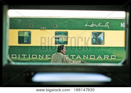 Passenger sitting on a bench and waiting for train at Karachi Cantt Station - 17-03-2013
